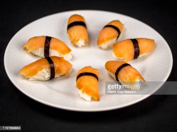 salmon sushi - pierre yves babelon stock pictures, royalty-free photos & images