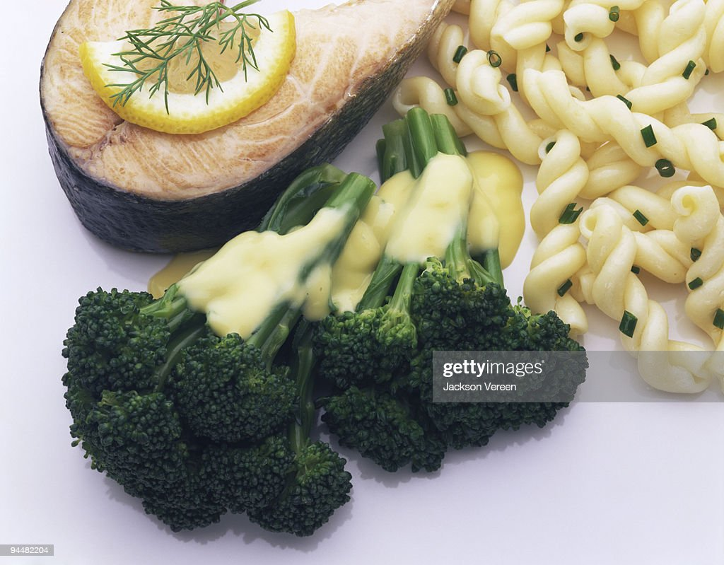 Salmon with broccoli and pasta : Stock Photo