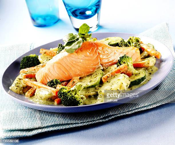 Salmon with vegetables in a herb and cream sauce
