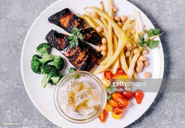 salmon with vegetables - bush bean stock photos and pictures