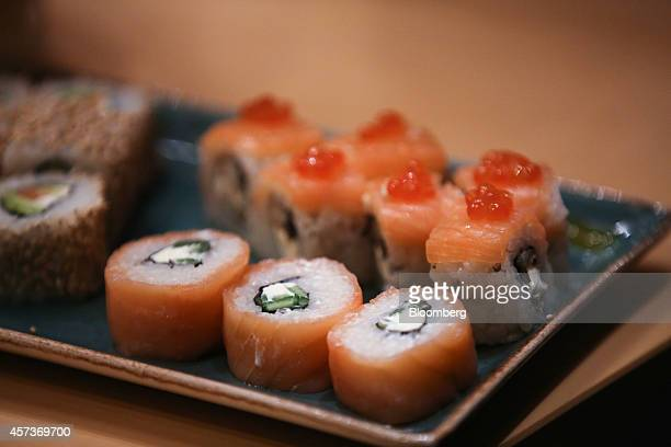 A salmonbased sushi dish prepared for a customer sits on a plate in the kitchen at a Planeta Sushi restaurant operated by Rosinter Restaurants...