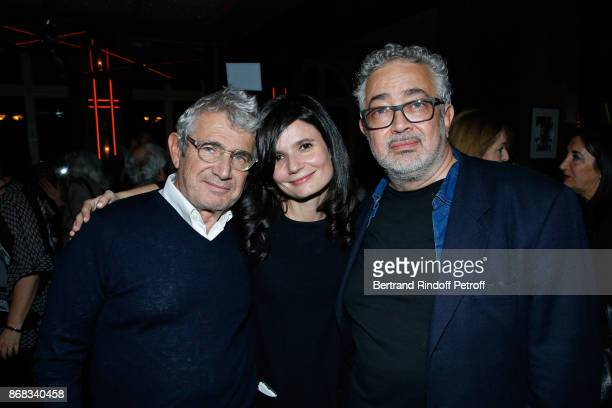 Salome Lelouch standing between Michel Boujenah and his brother Paul Boujenah attend Claude Lelouch celebrates his 80th Birthday at Restaurant...