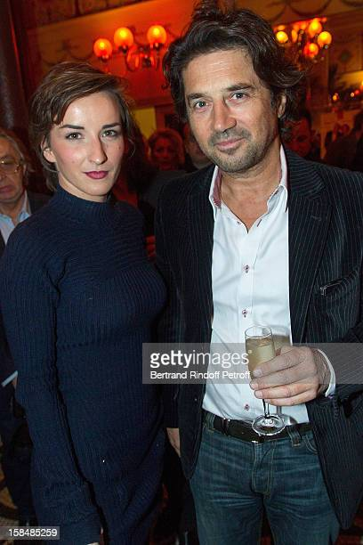 Salome Stevenin and Bruno Madinier pose at restaurant Le Grand Colbert on December 17 2012 in Paris France
