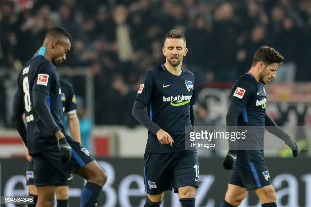 Salomon Armand Magloire Kalou of Hertha Vedad Ibisevic of Hertha and Mathew Allan Leckie of Hertha look dejected after the Bundesliga match between...