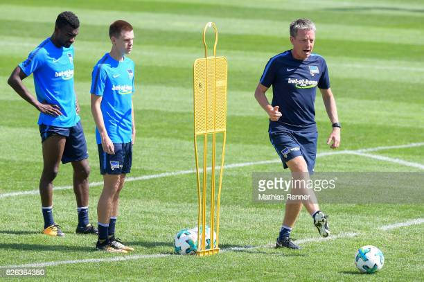 Salomon Kalou Julius Kade and assistant coach Rainer Widmayer of Hertha BSC during the training camp on August 4 2017 in Schladming Austria