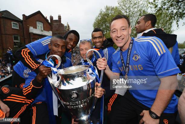 Salomon Kalou Mikel Chelsea owner Roman Abramovich Jose Bosingwa and John Terry pose with the Champions League trophy during the Chelsea victory...