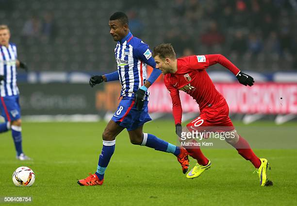 Salomon Kalou of Berlin battles for the ball with Daniel Baier of Augsburg during the Bundesliga match between Hertha BSC and FC Augsburg at...