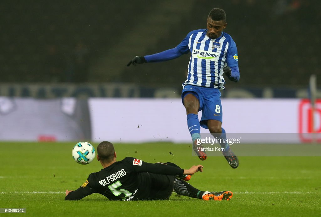 Salomon Kalou (R) of Berlin battles for the ball with Jeffrey Bruma of Wolfsburg during the Bundesliga match between Hertha BSC and VFL Wolfsburg at Olympiastadion on March 31, 2018 in Berlin, Germany.