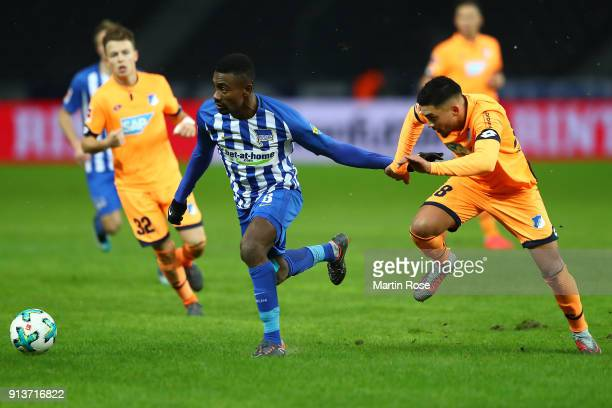 Salomon Kalou of Berlin fights for the ball with Nadiem Amiri of Hoffenheim during the Bundesliga match between Hertha BSC and TSG 1899 Hoffenheim at...