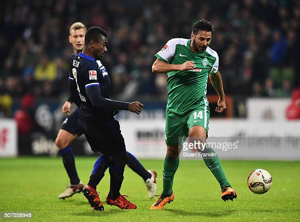 Salomon Kalou of Berlin is challenged by Claudio Pizarro of Bremen during the Bundesliga match between Werder Bremen and Hertha BSC at Weserstadion...