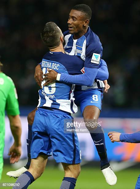 OVEMBER 04 Salomon Kalou of Berlin jubilates with team mate Vedad Ibisevic after scoring the first goal during the Bundesliga match between Hertha...
