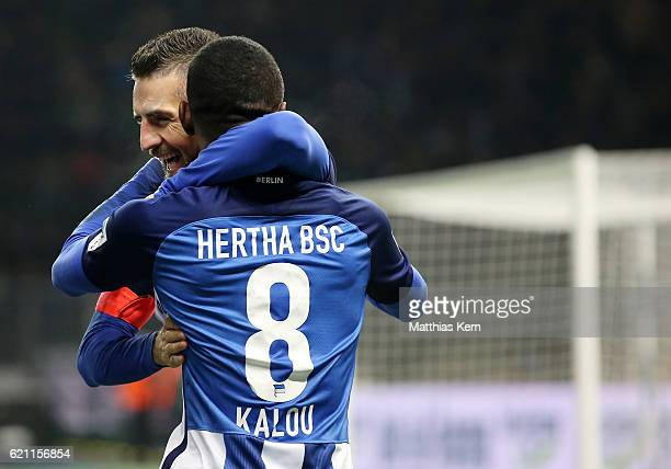 Salomon Kalou of Berlin jubilates with team mate Vedad Ibisevic after scoring the third goal during the Bundesliga match between Hertha BSC and...