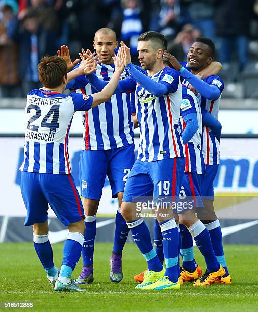 Salomon Kalou of Berlin jubilates with team mates after scoring the second goal during the Bundesliga match between Hertha BSC and FC Ingolstadt at...