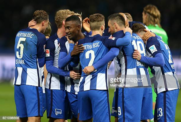 Salomon Kalou of Berlin jubilates with team mates after scoring the first goal during the Bundesliga match between Hertha BSC and Borussia...