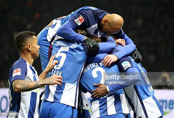 Salomon Kalou of Berlin jubilates with team mates after scoring the third goal during the Bundesliga match between Hertha BSC and Borussia...
