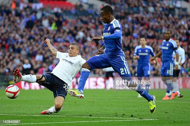 Salomon Kalou of Chelsea and Kyle Walker of Tottenham Hotspur tussle for the ball during the FA Cup with Budweiser Semi Final match between Tottenham...