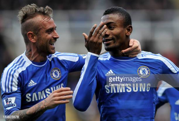 Salomon Kalou of Chelsea celebrates scoring his team's second goal with Raul Meireles during the Barclays Premier League match between Newcastle...