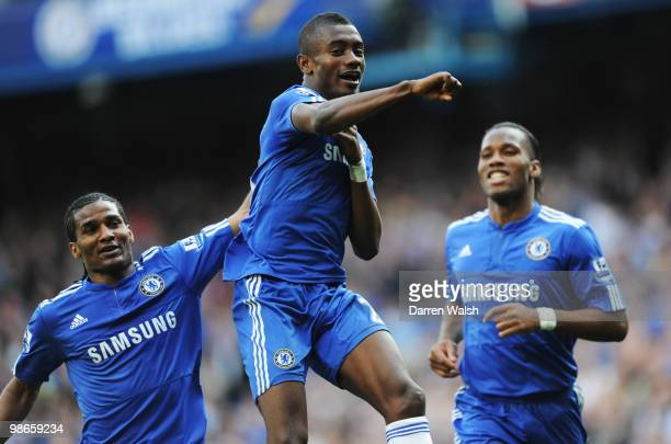 Salomon Kalou of Chelsea celebrates with Florent Malouda and Didier Drogba after scoring his third and his team's fourth goal during the Barclays...
