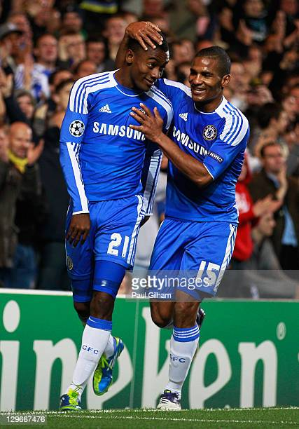 Salomon Kalou of Chelsea celebrates with Florent Malouda as he scores their fifth goal during the UEFA Champions League group E match between Chelsea...