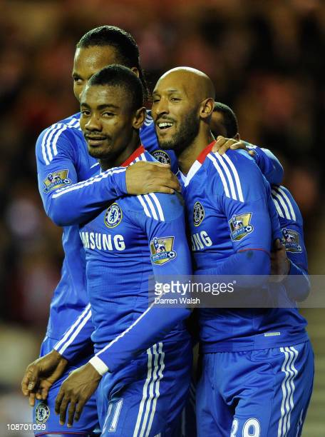 Salomon Kalou of Chelsea celebrates with his teammates Didier Drogba and Nicolas Anelka after he scores his team's second goal during the Barclays...