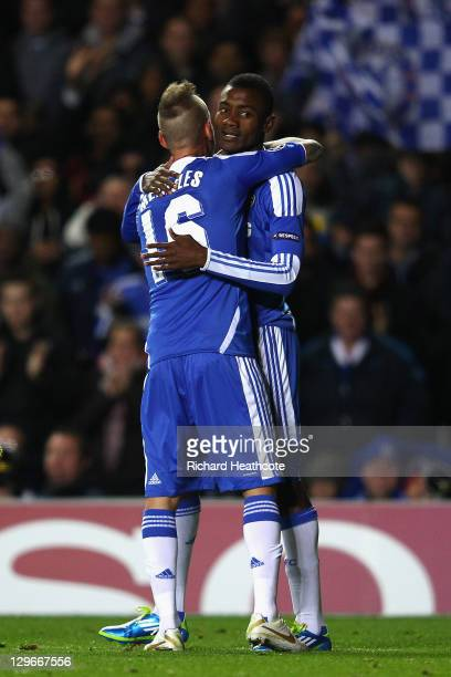 Salomon Kalou of Chelsea celebrates with team mate Raul Meireles after scoring his side's fifth goal during the UEFA Champions League Group E match...