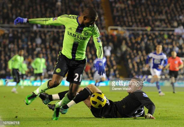 Salomon Kalou of Chelsea evades the challenge by Ben Foster of Birmingham City during the Barclays Premier League match between Birmingham City and...