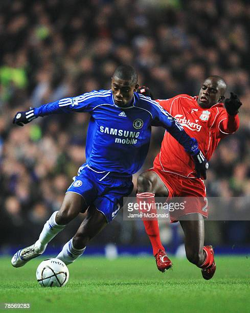 Salomon Kalou of Chelsea holds off the challenge of Momo Sissoko of Liverpool during the Carling Cup Quarter Final match between Chelsea and...