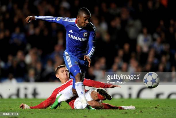 Salomon Kalou of Chelsea is tackled by Andrei Ivanov of Spartak Moscow as he closes in on the Spartak goal during the UEFA Champions League group F...