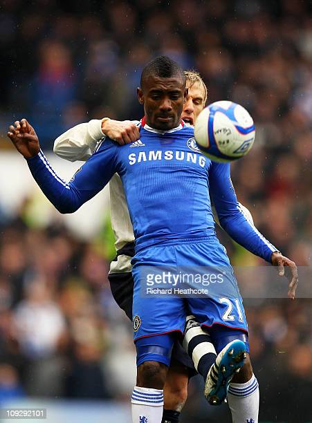 Salomon Kalou of Chelsea is tackled by Phil Neville of Everton during the FA Cup sponsored by EON 4th round replay match between Chelsea and Everton...