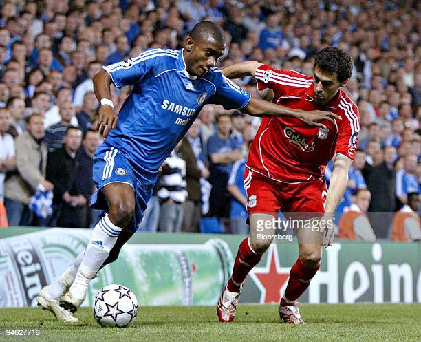 Salomon Kalou of Chelsea left dribbles as Javier Mascherano of Liverpool defends during the first game of their UEFA Champions League semifinal match...