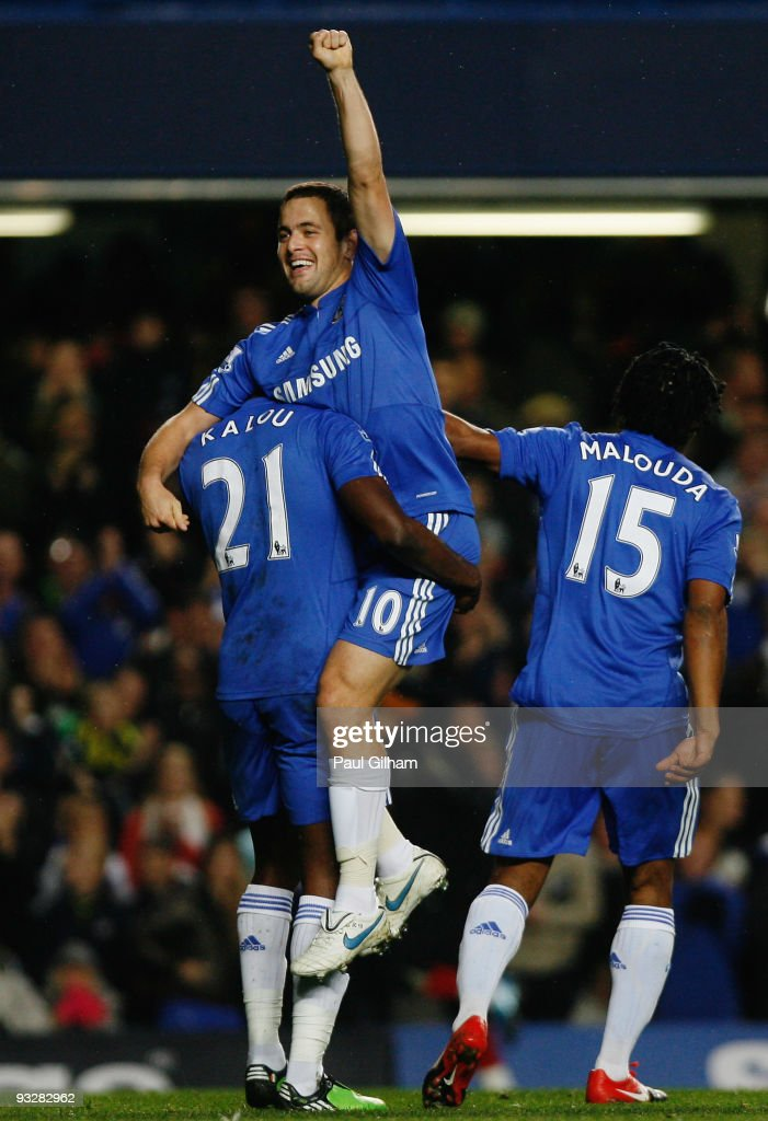 Salomon Kalou of Chelsea lifts Joe Cole in celebration of Cole scoring Chelsea's fourth during the Barclays Premiership match between Chelsea and Wolverhampton Wanderers at Stamford Bridge on November 21, 2009 in London, England.