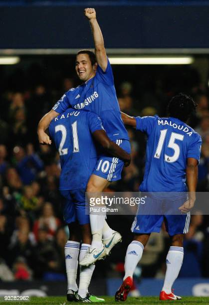Salomon Kalou of Chelsea lifts Joe Cole in celebration of Cole scoring Chelsea's fourth during the Barclays Premiership match between Chelsea and...