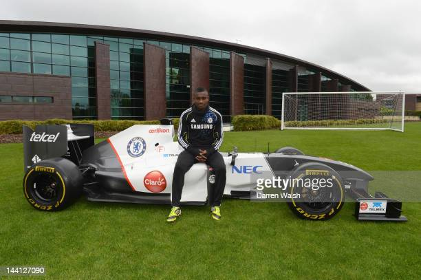 Salomon Kalou of Chelsea next to the Sauber F1 car to launch the Chelsea FC and Sauber partnership at the Cobham training ground on May 10, 2012 in...