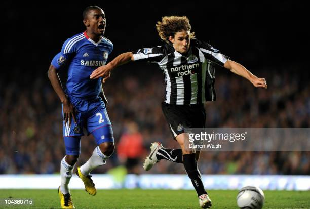 Salomon Kalou of Chelsea reacts as he pulls up injured after competing for the ball with Fabricio Coloccini of Newcastle during the Carling Cup third...
