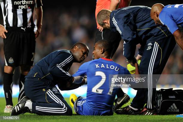 Salomon Kalou of Chelsea receives medical treatment after injuring himmselfduring the Carling Cup third round match between Chelsea and Newcastle...