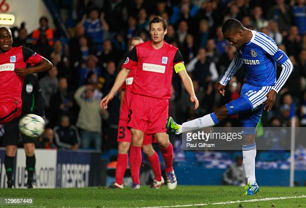 Salomon Kalou of Chelsea scores their fifth goal during the UEFA Champions League group E match between Chelsea and Genk at Stamford Bridge on...