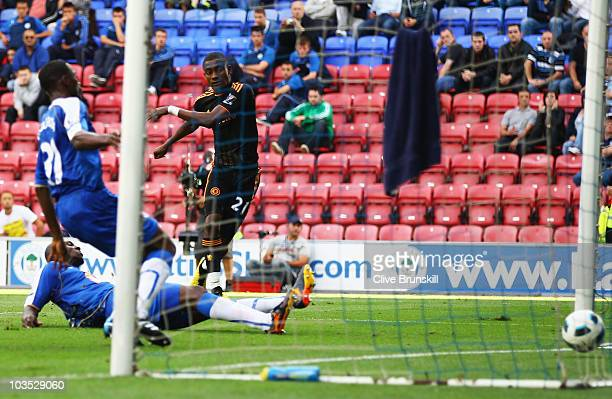 Salomon Kalou of Chelsea scores their fourth goal during the Barclays Premier League match between Wigan Athletic and Chelsea at DW Stadium on August...