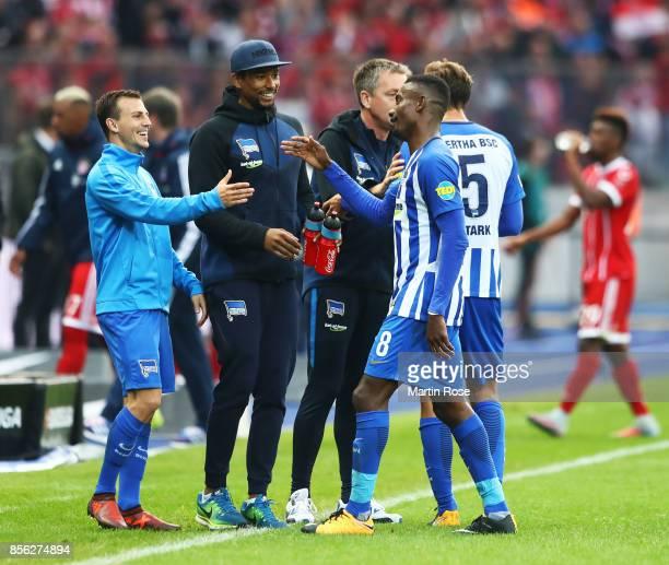 Salomon Kalou of Hertha Berlin is congratulated by Vladimir Darida of Hertha Berlin the Bundesliga match between Hertha BSC and FC Bayern Muenchen at...