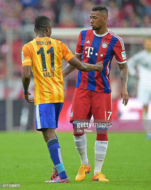 Salomon Kalou of Hertha BSC and Jerome Boateng of Bayern Muenchen klatschen sich ab during the game FC Bayern Muenchen against Hertha BSC on april...