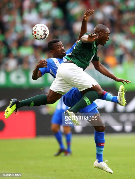 Salomon Kalou of Hertha BSC and Jerome Roussillon of VfL Wolfsburg battle for the ball during the Bundesliga match between VfL Wolfsburg and Hertha...