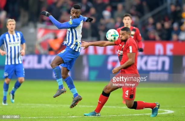 Salomon Kalou of Hertha BSC and Jonathan Tah of Bayer 04 Leverkusen during the first Bundeliga game between Bayer 04 Leverkusen and Hertha BSC at...