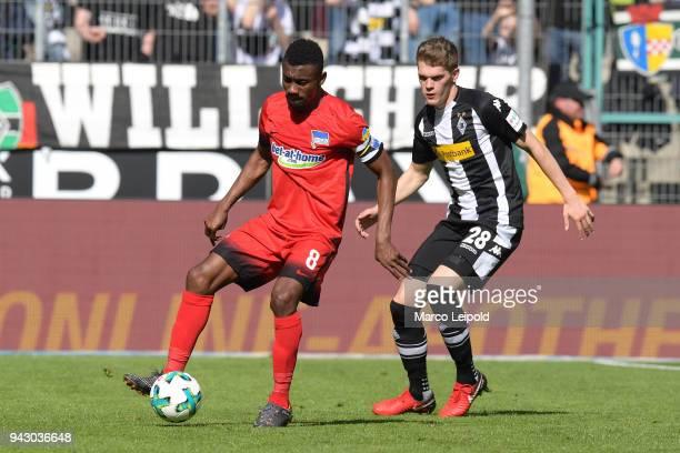 Salomon Kalou of Hertha BSC and Matthias Ginter of Borussia Moenchengladbach during the Bundesliga game between Borussia Moenchengladbach and Hertha...