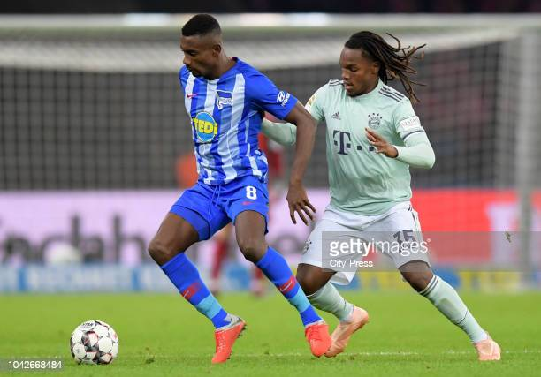 Salomon Kalou of Hertha BSC and Renato Sanches of FC Bayern Muenchen during the game between Hertha BSC and Bayern Muenchen at the Olympiastadion on...