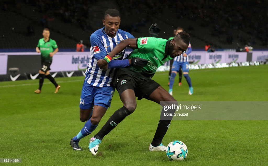 Salomon Kalou of Hertha BSC battles for the ball with Salif Sane of Hannover 96 during the Bundesliga match between Hertha BSC and Hannover 96 at Olympiastadion on December 13, 2017 in Berlin, Germany.