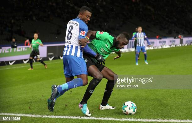 Salomon Kalou of Hertha BSC battles for the ball with Salif Sane of Hannover 96 during the Bundesliga match between Hertha BSC and Hannover 96 at...