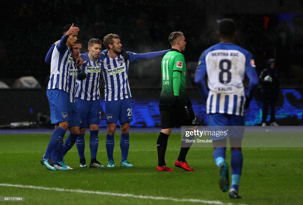 Salomon Kalou of Hertha BSC celebrates with team mates after scoring his team's first goal during the Bundesliga match between Hertha BSC and Hannover 96 at Olympiastadion on December 13, 2017 in Berlin, Germany.