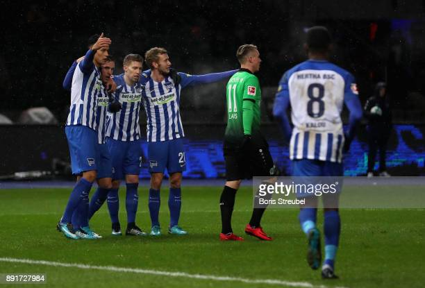 Salomon Kalou of Hertha BSC celebrates with team mates after scoring his team's first goal during the Bundesliga match between Hertha BSC and...