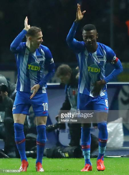 Salomon Kalou of Hertha BSC celebrates with teammate Ondrej Duda after scoring his team's first goal during the Bundesliga match between Hertha BSC...