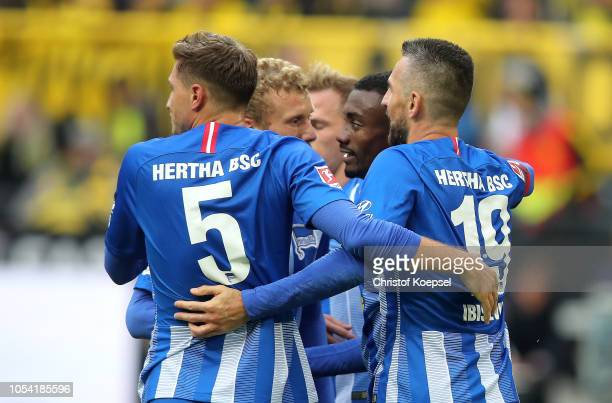 Salomon Kalou of Hertha BSC celebrates with teammates after scoring his team's first goal during the Bundesliga match between Borussia Dortmund and...
