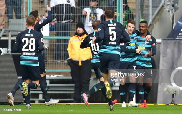 Salomon Kalou of Hertha BSC celebrates with teammates after scoring his team's first goal during the Bundesliga match between Borussia...